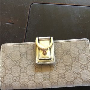 Gucci Gold leather and canvas wallet
